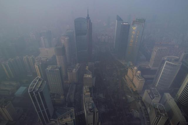 Buildings are seen through thick haze at the central business district in Guangzhou