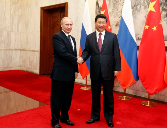 Russia's President Vladimir Putin and his Chinese counterpart Xi Jinping shake hands during a bilateral meeting at the Diaoyutai State Guesthouse in Beijing